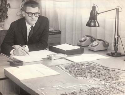 Fred Roche sitting at his desk working