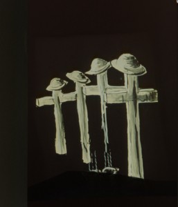 Black and white drawing of four crosses with soldiers hats on top.