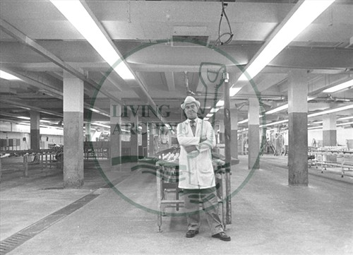 Interior of Scots Meats factory with lone worker after the closure 5th November 1981.  Illustrative photograph supplied by kind permission of BCHI (Accession Ref. BLE/P/123). Original donated by Living Archive.