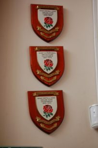 Three shields displayed at Bletchley RUFC Clubhouse