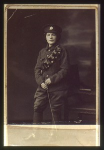 Slide of a woman in a man's military uniform.