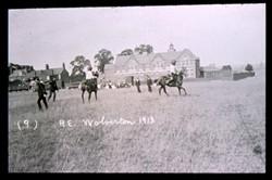 Slide of fencing on horseback.