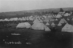 Slide of an army camp and guns.