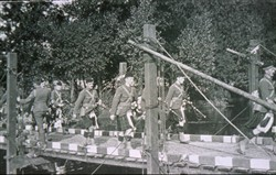 Slide of a Scottish Regimental Pipe-Band crossing a bridge.