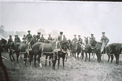 Slide of mounted officers and troops.