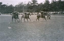 Slide of a horseback contest.