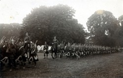 Photograph showing a company/battalion marching