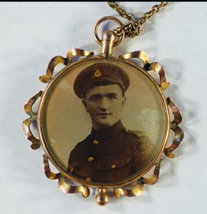 Pendant necklace containing photographs of Ted and Charlie Williams