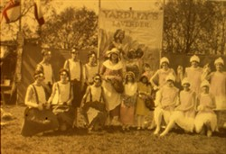 Slide of a group in fancy dress in front of a Yardley's Lavender banner.