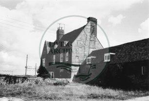 Photograph of Bradwell Abbey farmhouse and outbuildings (1971).