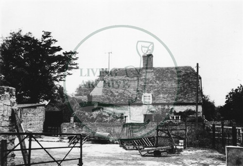 Photograph of farm and farmyard (1971).