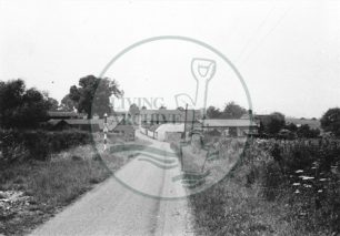 Photograph of country road and farm (1971).