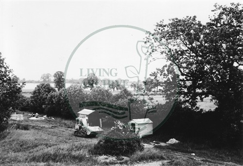 Photograph of heavy machinery in fields south of Stony Stratford (1971).