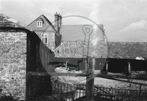 Photograph of farm buildings behind Georgian farmhouse (1971).