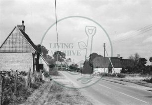 Photograph of road through Woolstone towards the church (1971).