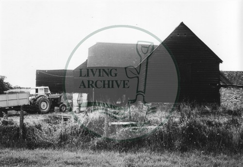 Photograph of farm building and tractor at Woolstone (1971).