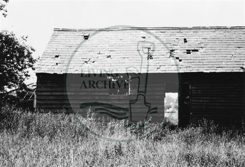 Photograph of derelict barn in field site of Coffee Hall (1971).