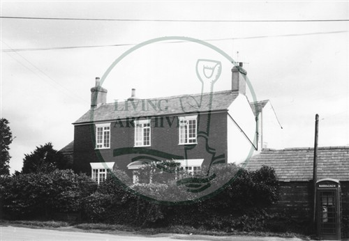 Photograph of farmhouse in Woolstone (1971).