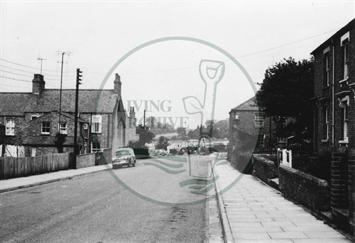 Photograph of New Bradwell street with terraced houses (1971).