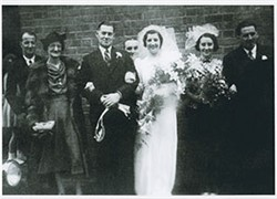 Frank Brown and Beryl Taylor on their wedding day with family.