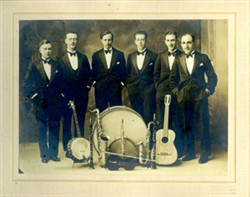 Six gentlemen and musical instruments.