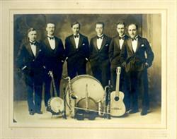 Six gentlemen and musical instruments.