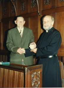 Frank Brown receiving a medal.