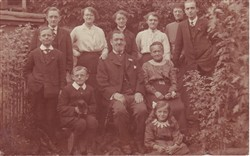 A family group in a garden.