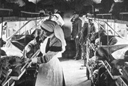 Interior of ambulance train with medical staff and patients