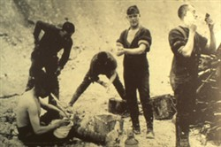 Slide of a photograph of five soldiers shaving