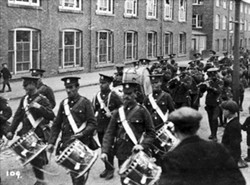Military band marching through Wolverton