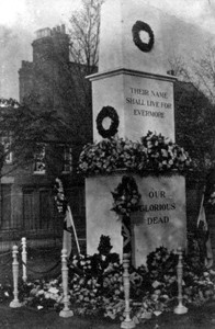 War memorial decorated with flowers