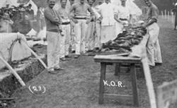 Group of men preparing and cooking food at Wolverton fair.