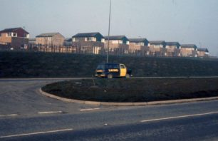 A housing estate and LAING minibus