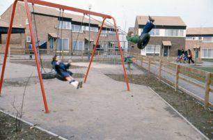 Two little girls on swings in Eaglestone