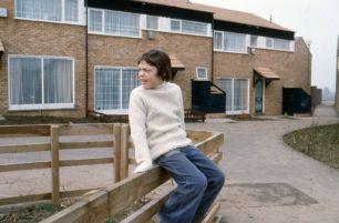 Boy sat on a fence in Eaglestone