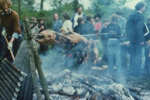 Ben Collins roasting the pig