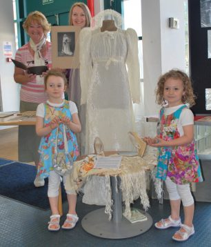 The wedding dress and accessories with Frank and Beryl's daughter Bernice (left), grand-daughter and great grand-daughters