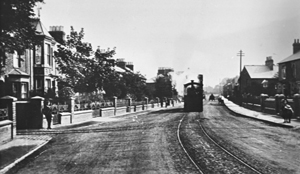 The tram making its way along Wolverton Road. Note the absence of other traffic and on road clutter. Note also the decorative railing on the top of the wall [XSSP028].