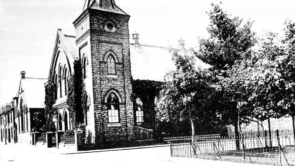 The Congregational Church on The Square, Wolverton. View shows the tower and the corner of the memorial garden, date unknown