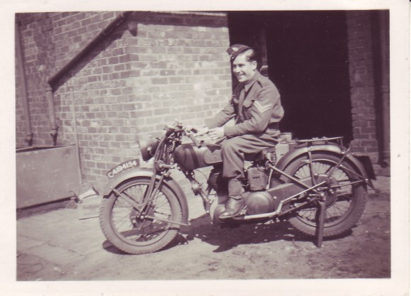 Mr. George Brind on a dispatch bike.
