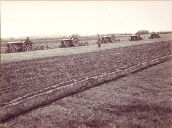 Tractors ploughing meadows at Home Farm