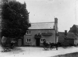Man with a horse-drawn trap outside The Barge Inn in 1910