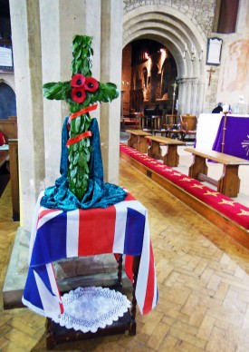 Cross and poppies in St James Church - James Denton remembered 14th March 2015