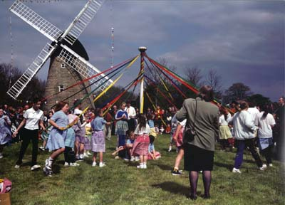 Maypole dancing in front of Bradwell Windmill