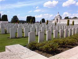 Colour photograph showing several rows of headstones.