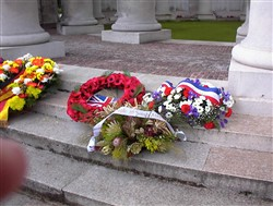 Colour photograph showing 4 wreaths on the steps of the Ploegsteert Memorial to the Missing at the Royal Berkshire Cemetery Extension.