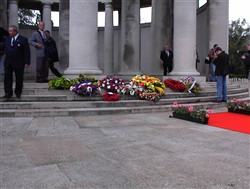 Colour photograph showing wreaths on the steps of the Ploegsteert Memorial to the Missing at the Royal Berkshire Cemetery Extension.