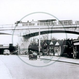 Railway flyover and the 'tin shops' at the end of Bletchley Road, 1962. Illustrative photograph supplied by kind permission of  BCHI (Accession Ref: BLE/P/991).