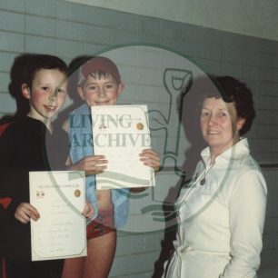 Bletchley Swimming Club: Mrs Eileen Corden presenting certificates. Photograph supplied by kind permission of BCHI (Accession Ref: BLE/P/3145).